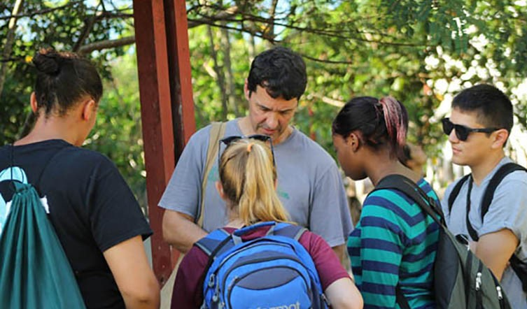 Marcelo tutoring students from Oswego New York State University in the use of GPS (Global Positioning System) to record features during a Projeto Puma expedition in the Brazilian Amazons.