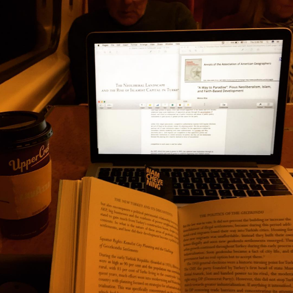 Abdulla works on his assignment on the train - Instagram photo