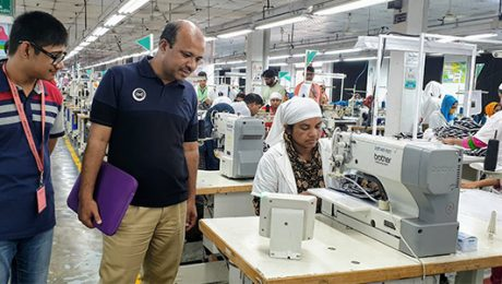 Mamunur Rahman with Ella users at the factory