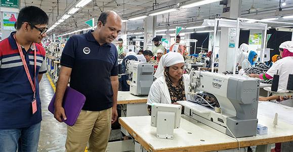 Mamunur Rahman with Ella users at the factory