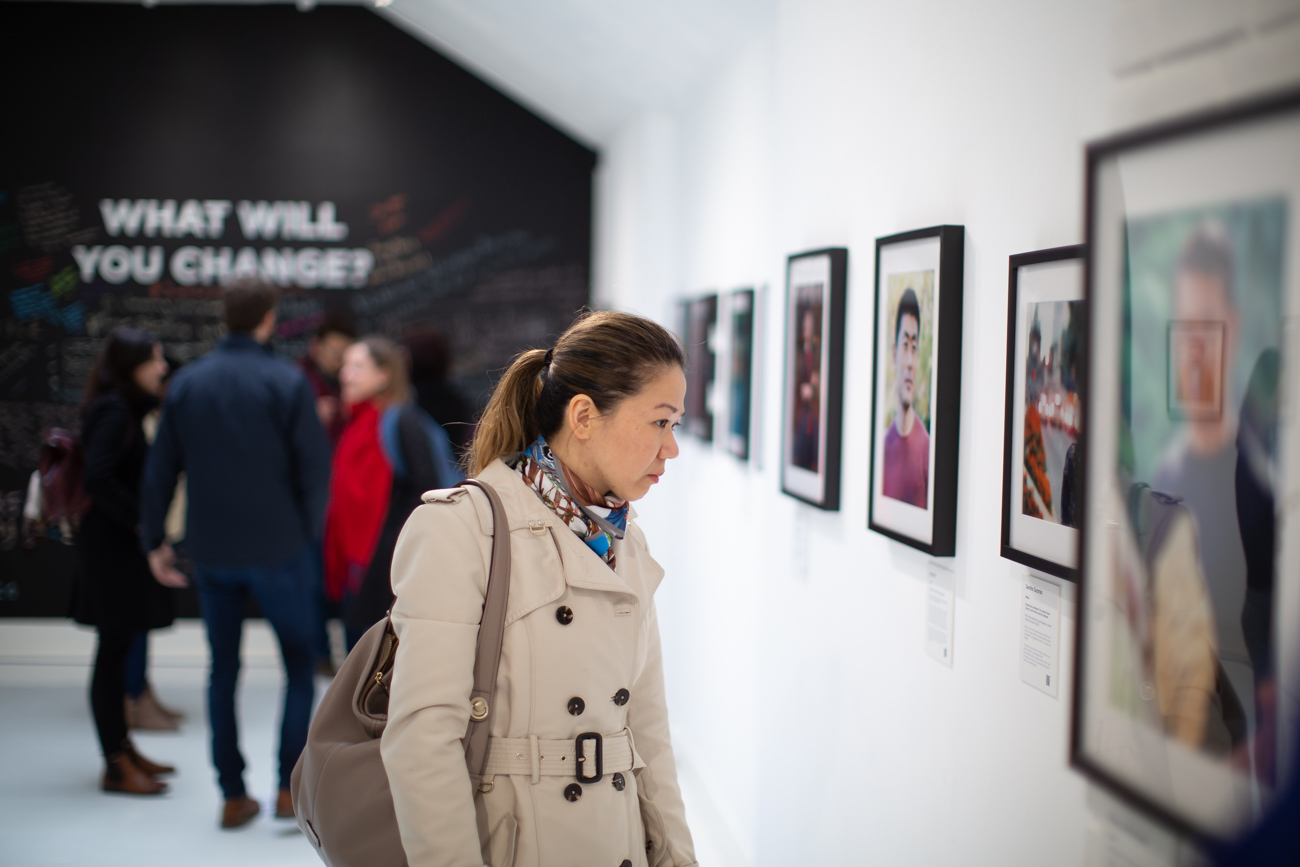 A Chevening Alumna surrounded by other great Cheveners at a photography exhibition in London
