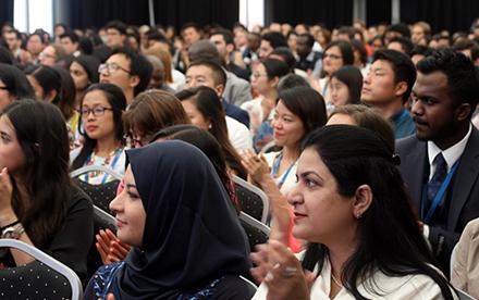 Scholars in auditorium
