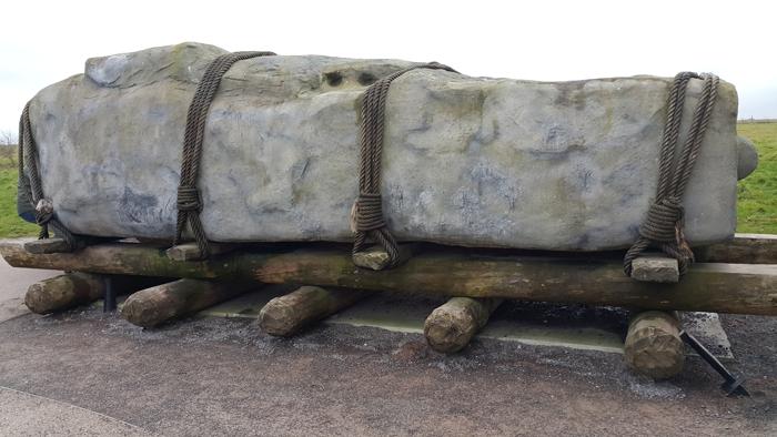 Stonehenge stone on logs